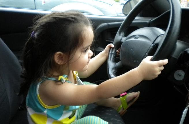 Little girl takes the wheel after father leaves car running. [blogspot]