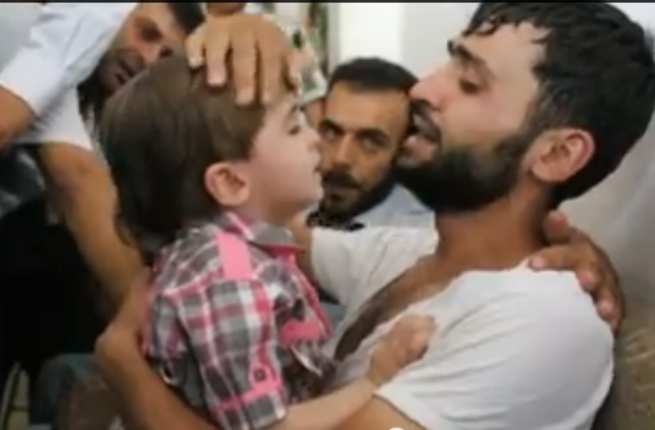 Screenshot of a young Syrian boy being reunited with his father, who believed he was dead. (YouTube)
