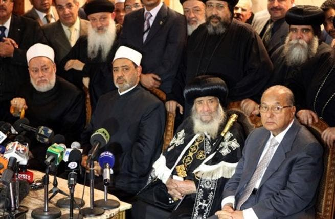 Pope Shenouda III of Alexandria, Egyptian Grand Imam of Al-Azhar Ahmed al-Tayeb, Egyptian Mufti Ali Gomaa and Egypt's Minister of Awqaf (religious endowments) Mahmud Hamdi Zaqzuq hold a joint press conference at the al-Abasseya Cathedral.