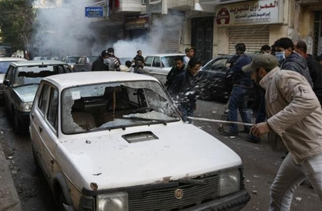 Egyptian Christian youths go on the rampage in the area of the Al-Qiddissine church.