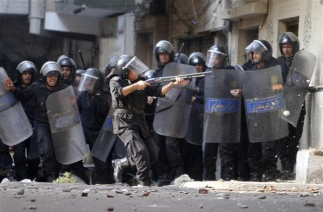 Egyptian riot police clash with stone-throwing Christian youths  outside the Al-Qiddissine church.
