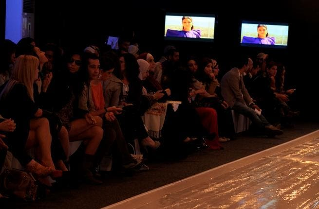 Front row fashionistas: shades in the dark and skyscraper heels