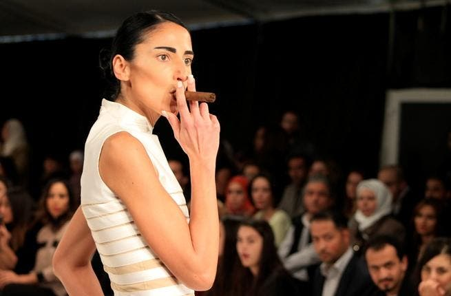 No smoke without fire: pushing boundaries, models smoked cigars and cracked riding whips on the catwalk