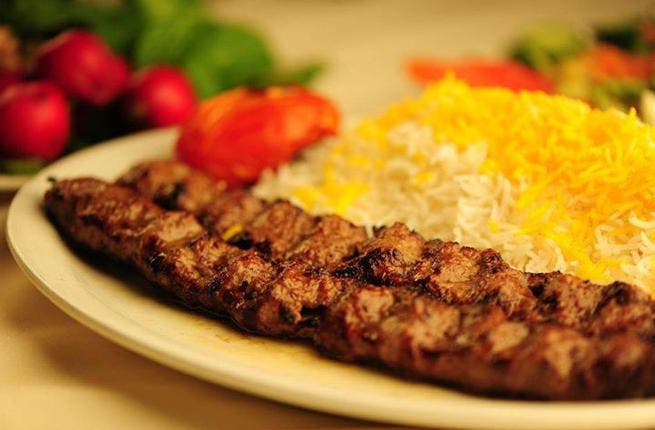 The Persian palate: Grilled tomatoes and butter set off the Iranian traditional dish of kebab and basmati rice. Also known as Chelo Kebab, Iran's warming dish is seasoned with saffron and served with a sour yoghurt drink.