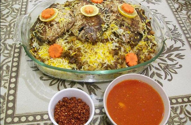 Kuwait's Kabsa with Daqous: This fish rice curry carries hints of the East. Native to other Persian Gulf states, it's all about a stuffed fish lined with coriander and garlic and sprinkled with aromatic rose water and saffron.
