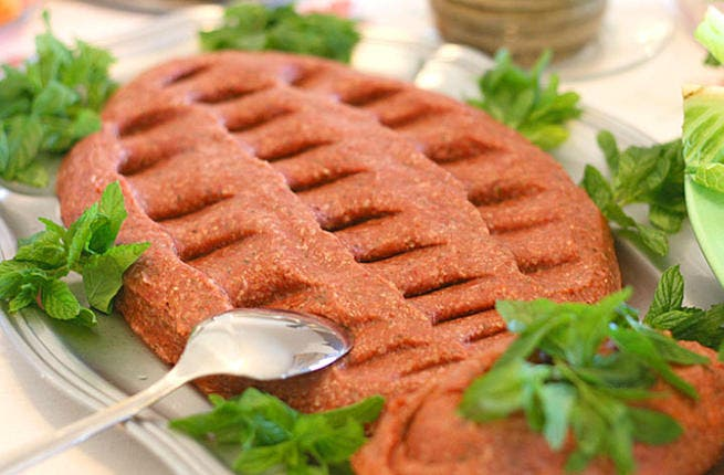 Lebanon's gritty gourmet: Kibbeh Nayyeh - if you're a sushi fan who happens to love a bit of red-meat - is a must-try!  This rough n ready raw delicacy takes more prep than some cooked creations: Minced beef or lamb meticulously blended with fine bulgur and spices galore, whipped up with fresh mint & olive oil, and ready for the mezza platter.