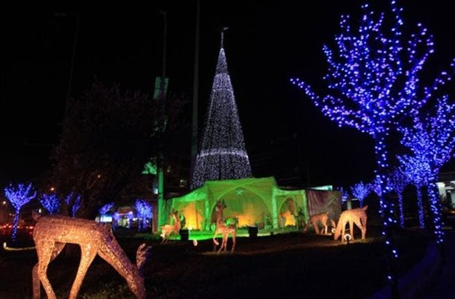 A Christmas tree and ornaments decorate a park in the Beirut suburb of Sin el-Fil.