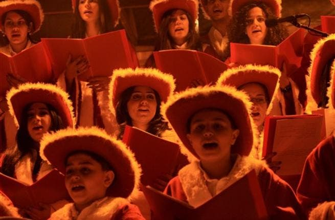 A Christian choir wearing cowboy hats sing during Christmas Eve celebrations, in the Ashrafiyeh neighborhood of east Beirut.
