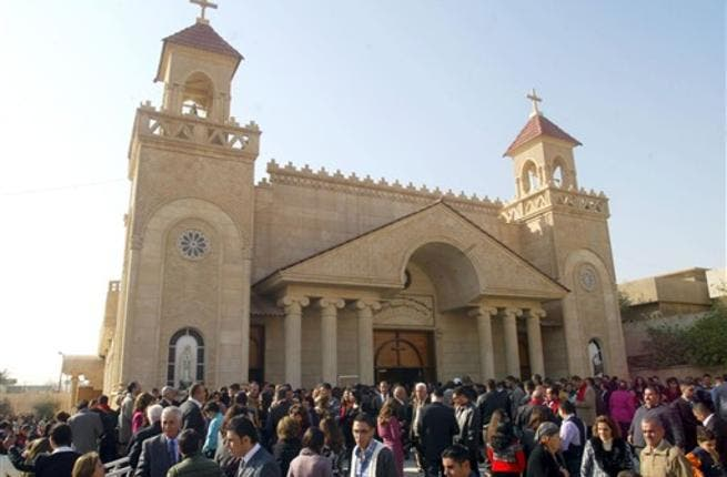 Iraqi Chaldean Catholics gather ouside the Cathedral of Kirkuk following Christmas day mass in northern Iraq.