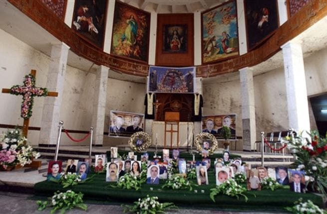 A shrine for Iraqi Christians who were killed in Al-Qaeda siege is erected at Sayidat alNejat Church in Baghdad  as Christmas for Iraqi Christian community will this year be a time of fear and cancelled celebrations instead of rejoicing following renewed threats by Al-Qaeda and the church massacre.