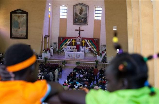 South Sudanese attend a Christmas service at the Juba Catholic cathedral, in the southern Sudan's capital city, in what may be their last Christmas in a unified Sudan.
