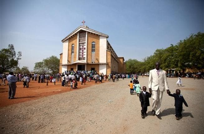 South Sudanese gather following the Christmas service at the Juba Catholic Cathedral, in the southern Sudan's capital city.