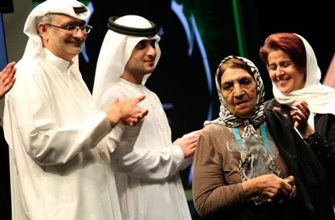 Kobra Hasanzadeh Esfahani (2nd R) of Iran receives the Muhr AsiaAfrica best actress award for her role in Alireza Davoodnejad's film Salve.