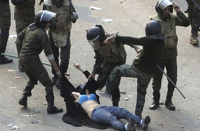 This 'blue-bra'd' girl is the iconic image for Egypt's post-revolution. Her graphic ordeal stands for indiscriminate violence to Muslim & Christian alike at the hands of the army. This veiled protestor was strewn in an undignified state when soldiers rough-handled her. Ripped apart at the seams, she diverted our eyes from the burning Churches.