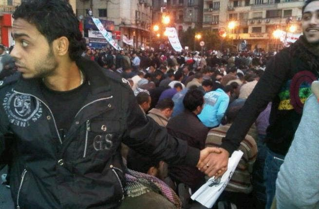 Copts protect Muslim countrymen: Tahrir undivided. The iconic image of Christians forming a human shield around Muslim worshippers during Friday prayers to protect them from pro-Mubarak thugs reminds us of a dream still to be realized. Since the ouster, the news is strewn with burning churches & intense violence between Muslim & Christian.