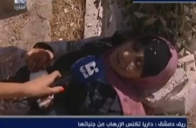 Dying to be interviewed: Dounia presenter, Micheline Azar, visited the massacre at Darya to thrust microphones in the faces of the traumatized and the dying. She later interviewed an orphan surrounded by children's corpses.