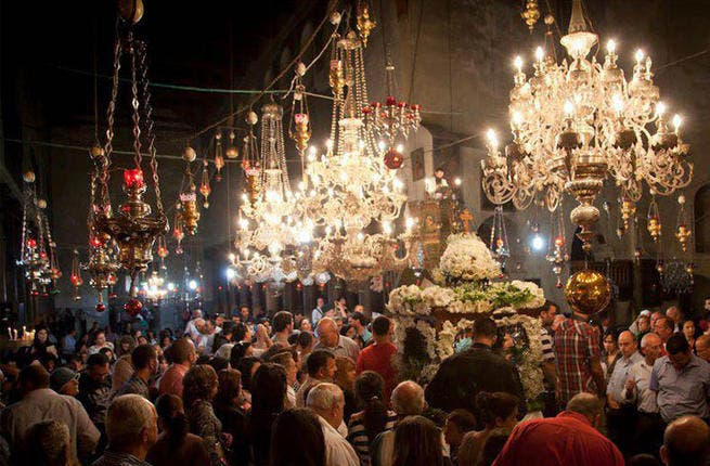 Orthodox Christians in Bethlehem gather for a ceremony at the Church of the Nativity on Friday, in a gilded and glittering celebration.