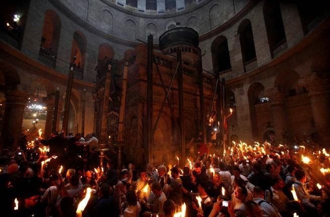 In Jerusalem's old city, Orthodox Christians hold candles lit from 'Holy Fire' in the Church of the Holy Sepulchre. The significance lies in the belief that fire was sent from heaven to light candles held by the  Orthodox patriarch in a tradition that dates back to the 4th century, symbolising the resurrection of Christ.