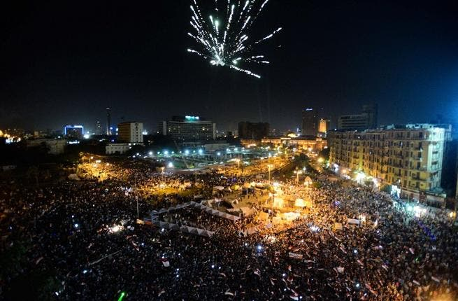 Fireworks light the sky as thousands of Egyptians gather to demonstrate against President Mohamed Morsi and the Muslim Brotherhood in Cairo's landmark Tahrir Square (AFP)