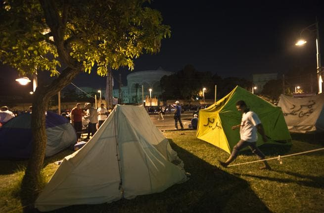 Opponents to Egypt's Islamist President set up tents in front of the Egyptian presidential palace during a sit-in in Cairo (AFP)