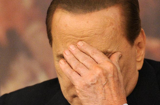 Italian Prime Minister Silvio Berlusconi gesturing during a press conference following a ministers' council. An Italian court on June 30, 2013 sentenced Silvio Berlusconi to seven years in jail and also banned the former prime minister from holding public office. (Photo AFP)