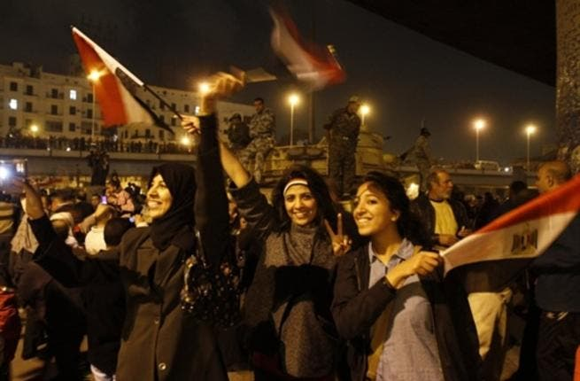 Egyptians celebrate the ousting of Mubarak in Cairo on the night of Friday, February 11, 2011