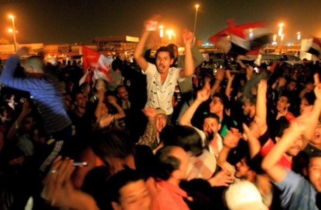 Egyptians in the Sudanni capital, Khartoum, hail the fall of Mubarak who succumbed to a series of popular protests that lasted for 18 days.