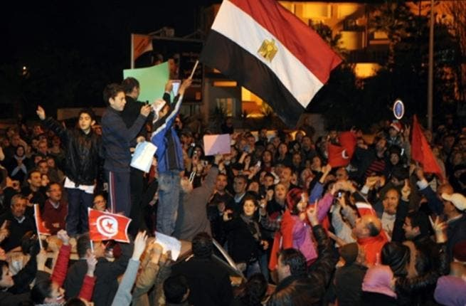 Tunisians, doubly jubilant after their own barely month-old victory pioneering- leaving- leader-  celebrating the latest candidate for resignation from power from the Egyptian embassy in Tunis.