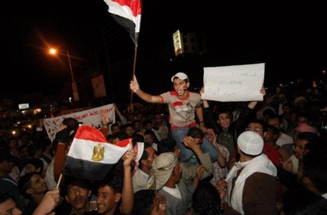 Yemenis Yell outside the Egyptian Embassy in Sana'a in commemoration of a crashing fall following a 30-year regime.