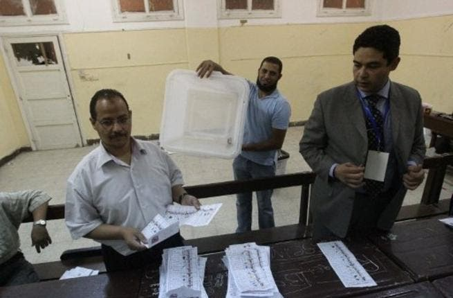 Egyptians happy to lend a helpful hand: It may have been a first fair election but this was still Egypt! Polling station clerks couldn't quite help themselves from giving their own personal recommendations of who to vote for. The usual suspects were Shafiq and Mursi but staff at the stations were keen to advise voters on their own favorites.