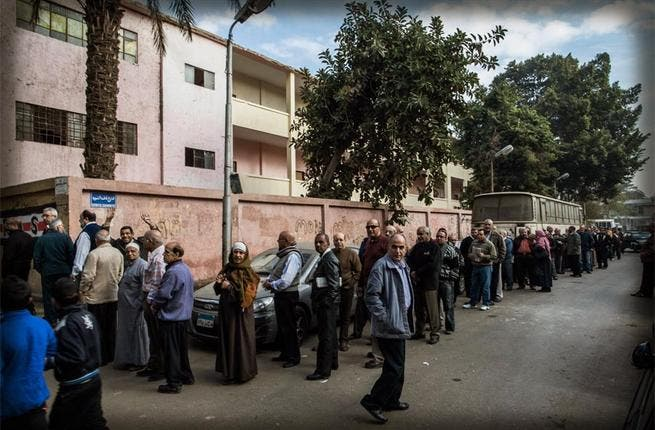The right not to vote: The Muslim Brotherhood declared a narrow victory in the first round of a polarizing constitutional referendum, while opposition members complained of polling violations. Voter turnout was low, estimated at between 31 and 33 percent, and widespread irregularities at polling stations were reported.