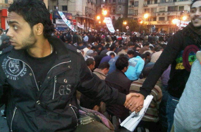 All Egyptians rally round each other: Coptic Christian Egyptians protecting the Muslim Egyptians during prayer.