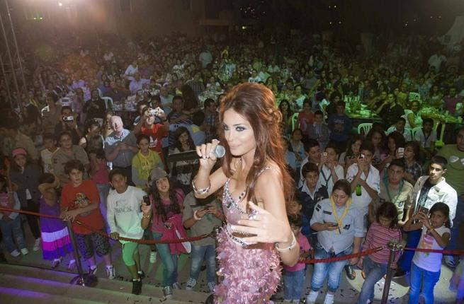 'Dominique' sings to an audience of 2500 people who came to her concert as part of the