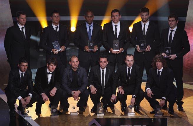FIFA World XI award players back row L to R: Marco Van Basten who presented the award,Ronaldo,Maicon,Lucio,Gerard Pique,Iker Casillas, front row L to R: David Villa,Lionel Messi,Wesley Sneijder,Xavi,Andres Iniesta,Puyol.