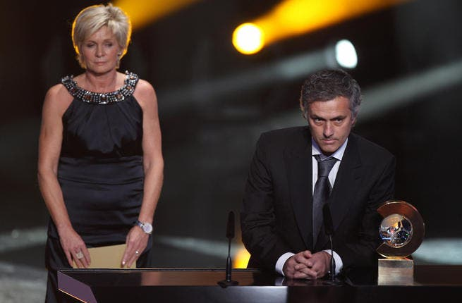 Jose Mourinho (R) of Portugal receives the coach of the year award alongside Silvia Neid of Germany winner of the women's coach of the year award.