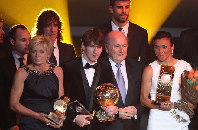 Silvia Neid (L) of Germany winner of women's coach of the year, Lionel Messi (2nd L) of Argentina winner of the men's player of the year,FIFA President Sepp Blatter (2nd R) and Marta (R) of Brazil winner of the women's player of the year.