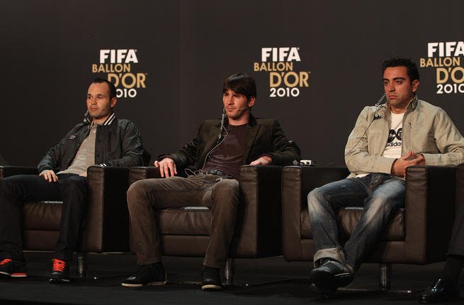 Lionel Messi (C) of Argentina alongside Xavi (R) and Andres Iniesta (L) of Spain during a press conference ahead of the FIFA Ballon d'or Gala.