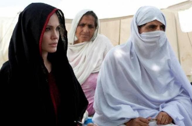 Angelina Jolie, 'Mother Teressa' to World Refugees, spent time in Ramadan, 2010, in a Pakistan refugee camp - donating generously to refugees. While she would have donned the traditional head scarf any time of  year, she took extra care to veil her whole head during this symbolically Muslim month.