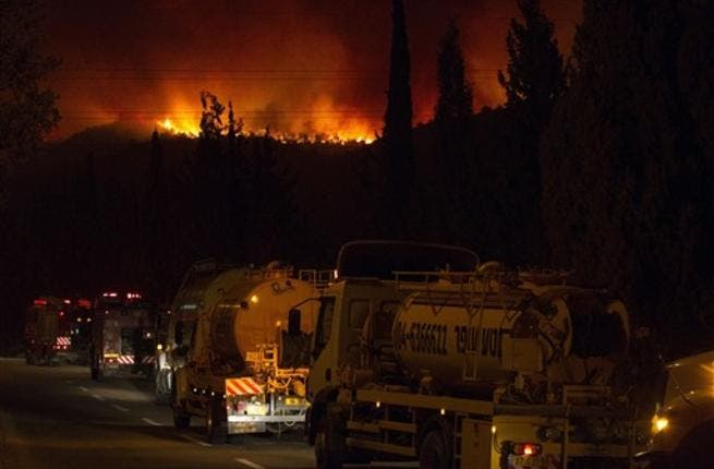 Israeli water tankers arrive to extinguish  a raging fire  in the city of Kiyriat Carmel, Carmel Forest
