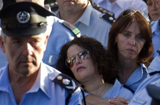 Israeli police officers mourn during the funeral of their comrade, Haifa Police Chief Ahuva Tomer. The death toll from Israelv massive forest fire rose to 42 with the death of Tomer, Israeli public radio reported.