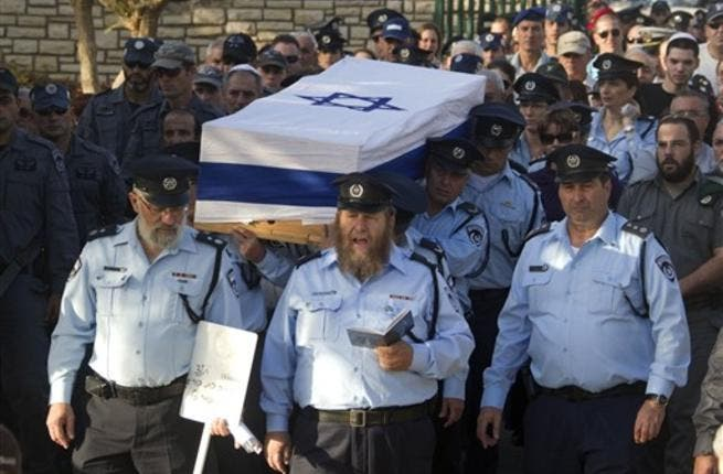 Israeli police officers carry the coffin of their comrade, Haifa Police Chief Ahuva Tomer, who died of her wounds after she was trapped with her car in raging fires which erupted in the Carmel Forest near Haifa.m