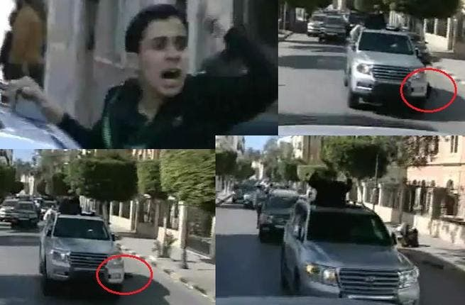 Fist-air-punching Gaddafi on his latest public outing:– his boy supporter falls flat from the Gaddafi-car-mobile, and Gaddafi only momentarily glances at him before carrying on thumping the air, unfazed.