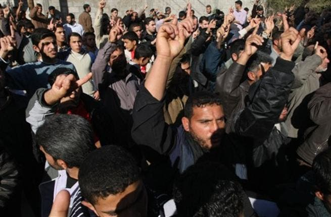 Islamic Jihad supporters protest as they mark the second anniversary of Israel's three-week offensive on the Gaza Strip.