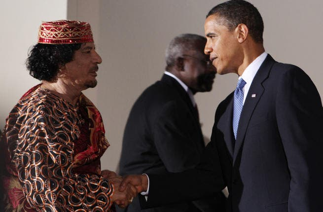 Other world leaders are not immune to the charms of this bizarre personality : Gaddafi shakes hands with U.S. President Barack Obama during the G8 summit on July 9, 2009 in L'Aquila, Italy.
