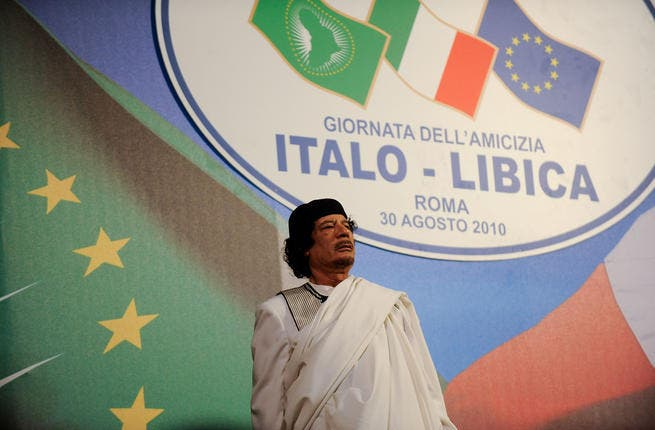 Gaddafi always one for the spotlight: here on an official two-day visit to Italy for talks with another colorful leader Prime Minister Silvio Berlusconi.