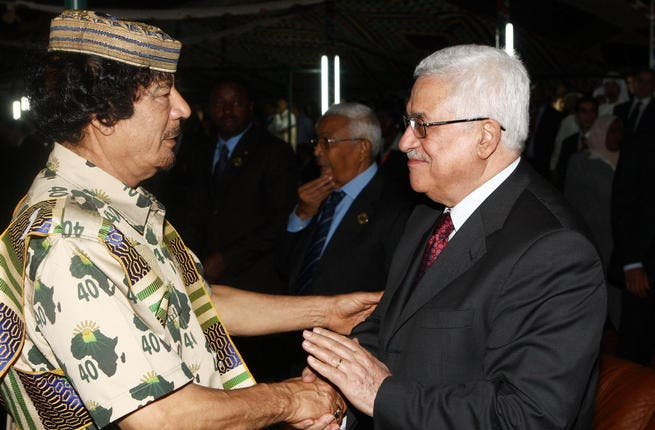 Palestinian President Mahmoud Abbas (R) greets Libyan leader Muammar Gaddafi on August 31, 2009 in Tripoli, Libya.  Libya is set for a week-long celebration to mark the 40-year anniversary of Muammar al-Gaddafi's rise to power.