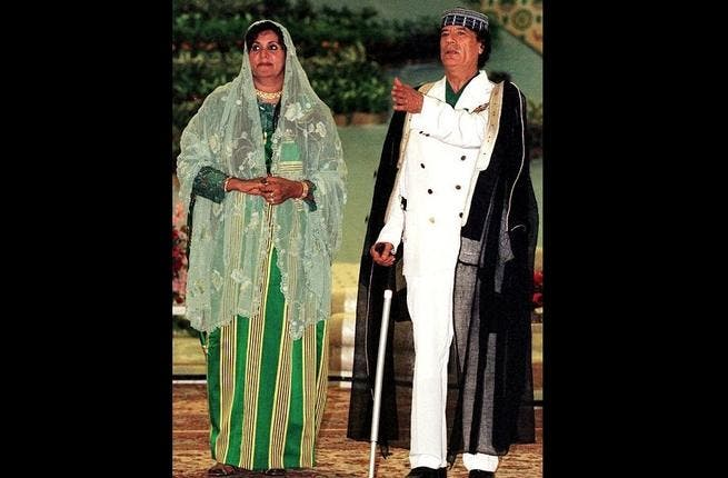 Husband and Wife pose for a Kodak moment, costumed out as always in readiness for the family album. Wife Safia was