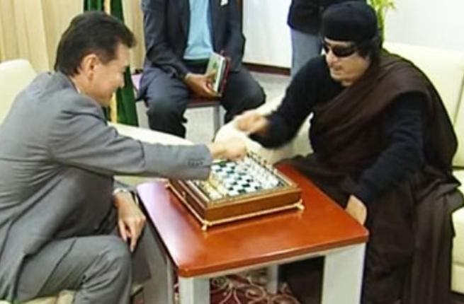 Still playing games with us, Moammar? Always full of surprises: as the world waits for his next move we can count on him to keep it flamboyant and bizarre. Here seen on Libyan state TV in June, the Libyan leader has been playing chess with the visiting Russian head of the World Chess Federation.