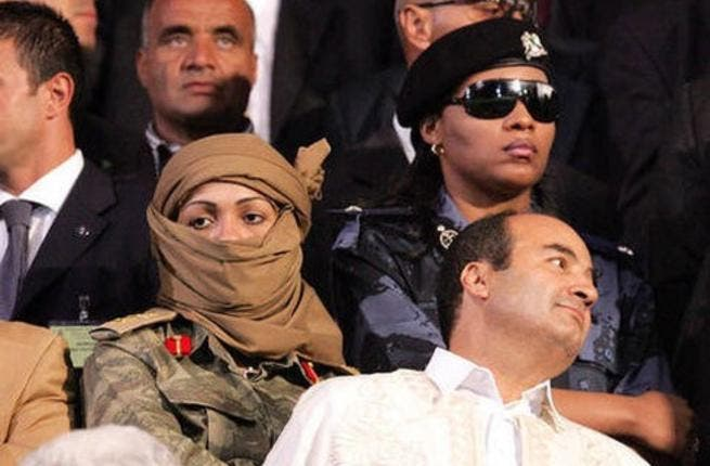 Gaddafi insists on selecting female guards for his belief in their sixth sense that allows them to sense danger. Or that they look hot carrying guns. He's got a penchant for nurses too we hear.