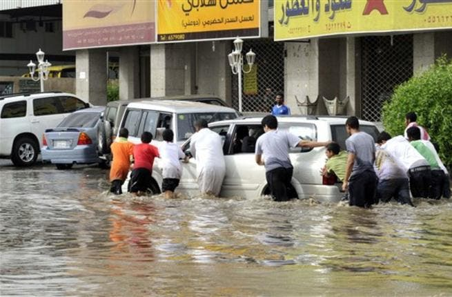 As many Saudi men gathered together for help, they succeeded to move the stuck car.
